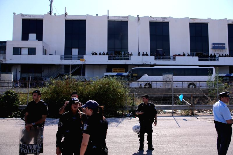 ATHENS, June 2, 2017 - Greek policemen evacuate migrants and refugees from the Athens old airport of Hellenikon in Athens to the new state-run facilities on June 2, 2017. A Greek police operation was ...