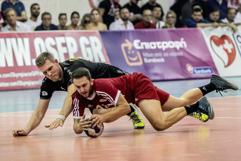 ATHENS, June 7, 2018    AEK's Jonas Lokken (L) vies with Olympiacos' Panagiotis Stoumpis during the Greek Men's Handball Championship Final between AEK and Olympiacos in Athens, Greece, June ...