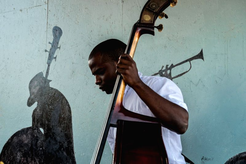 ATHENS, May 10, 2017 - A musician of the Municipal Youth Orchestra of Caracas from Venezuela performs at?Skaramangas refugee camp near Piraeus, Greece, on May 10, 2017. The Venezuelan musicians gave ...