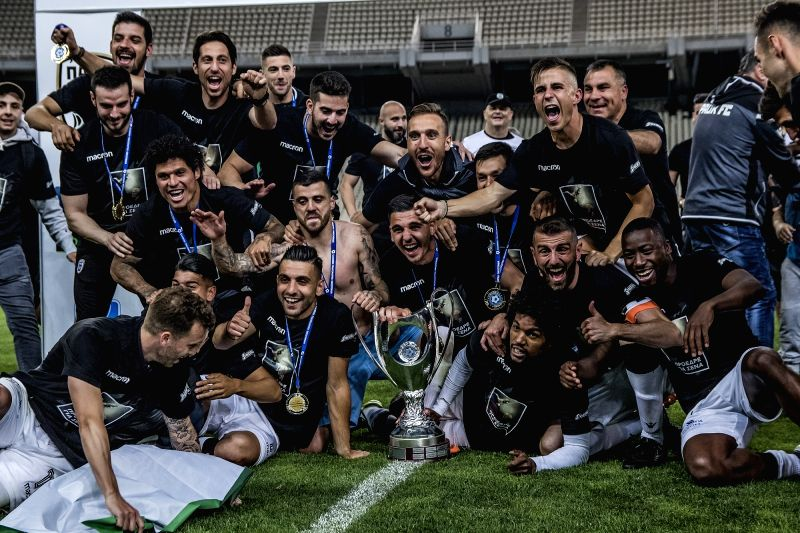ATHENS, May 13, 2018 - Members of PAOK Thessaloniki celebrate with the trophy after the Greek Cup Final soccer match against AEK Athens at the Olympic Stadium in Athens, Greece, on May 12, 2018. PAOK ...