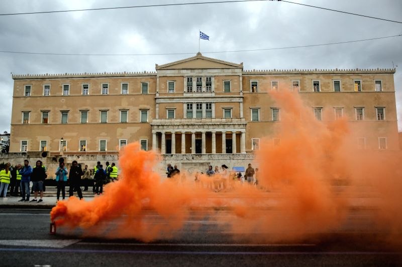 ATHENS, May 17, 2017 - Flare smoke is seen during a demonstration of uniformed staff members to protest against austerity measures in Athens, Greece, on May 17, 2017. Greece was hit on Wednesday by a ...