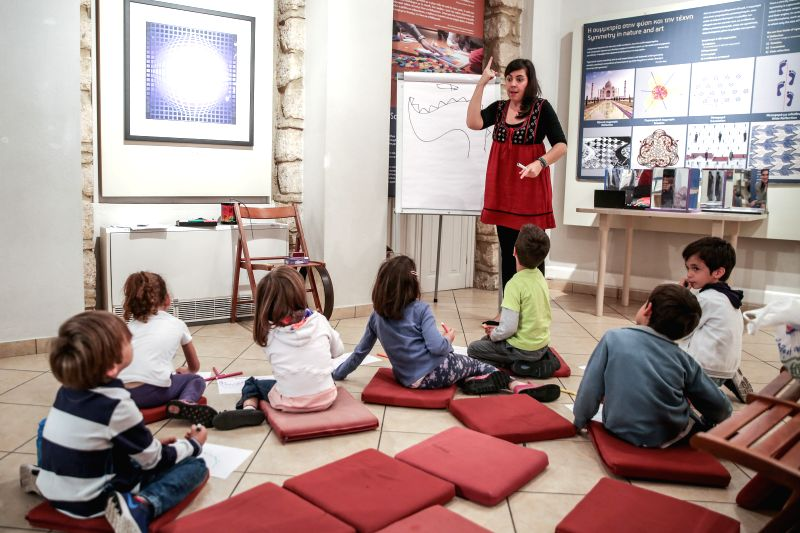 ATHENS, May 28, 2017 - Storyteller Vassilia Vaxevani (C, Rear) narrates the tale of the four great dragons to inspire children to paint their own Chinese dragons at an art workshop at the Museum ...
