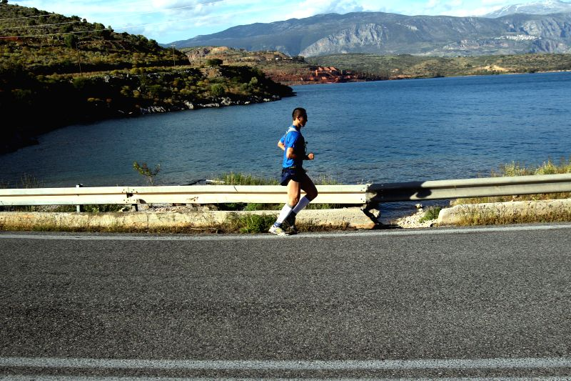 Greek athlete Tasios Georgios runs at the 3rd Dolichos Ultra Marathon race in central Greece on May 2, 2014. A total of 26 athletes, among them a Chinese, aim to run ..