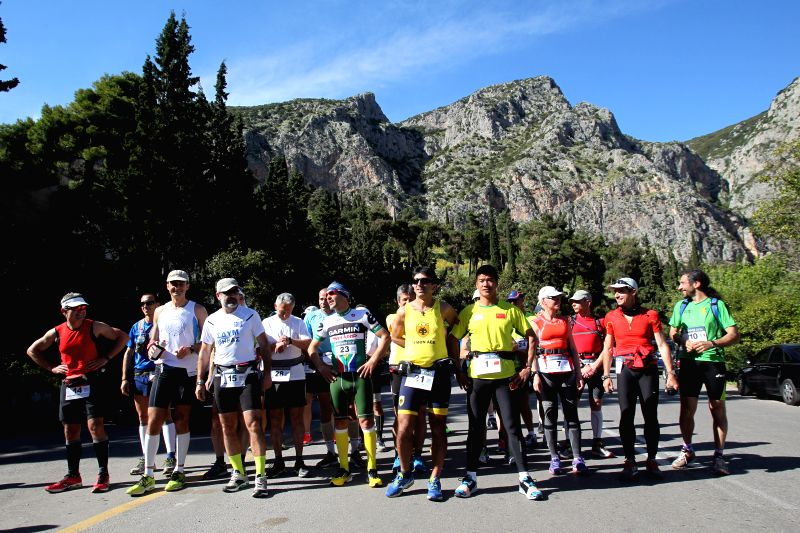 Participants in the 3rd Dolichos Ultra Marathon race pose for photograph at the starting point in front of the archaeological site of Delphi in central Greece on May ..