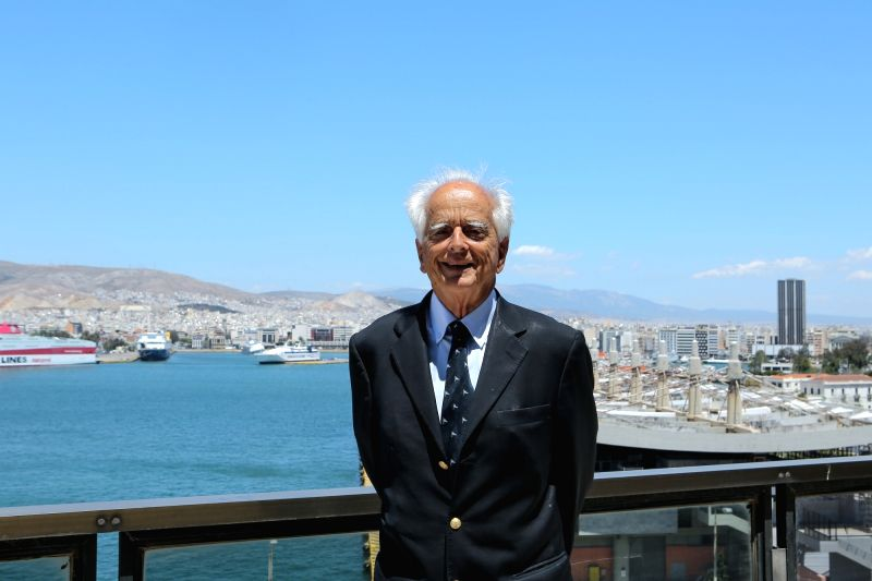 ATHENS, May 30, 2016 - Andreas Potamianos, president of the Greece-China Association, poses at the balcony of his office overlooking Piraeus port, Greece, on May 16, 2016. In the final stretch to the ...