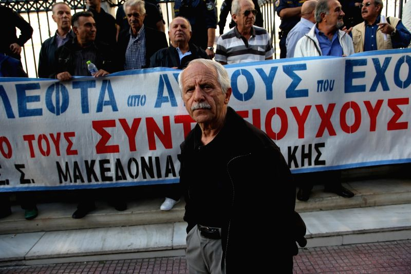 ATHENS, Oct. 6, 2017 - Greek pensioners participate in a symbolic protest in Athens, Greece, on Oct. 6, 2017. Greek pensioners held the symbolic protest outside Greece's supreme administrative court, ...