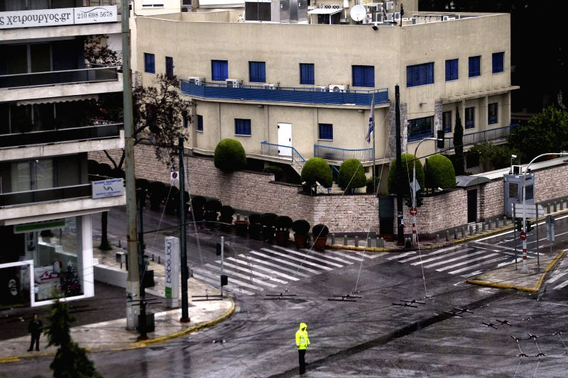 Police guard outside Israeli Embassy as the avenue keeps closed for the traffic after a pre-dawn gunfire attack in Athens, Greece, Dec. 12, 2014. Two to four unidentified motorcyle-riding ...