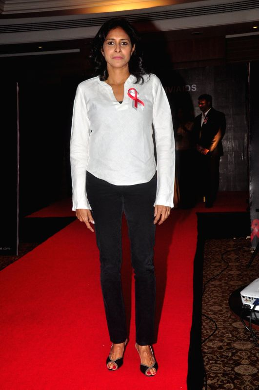 Athlete Reeth Abraham walks the ramp for AIDS awareness on World Aids Day to make India AIDs stigma free in Mumbai on Dec 1, 2014.