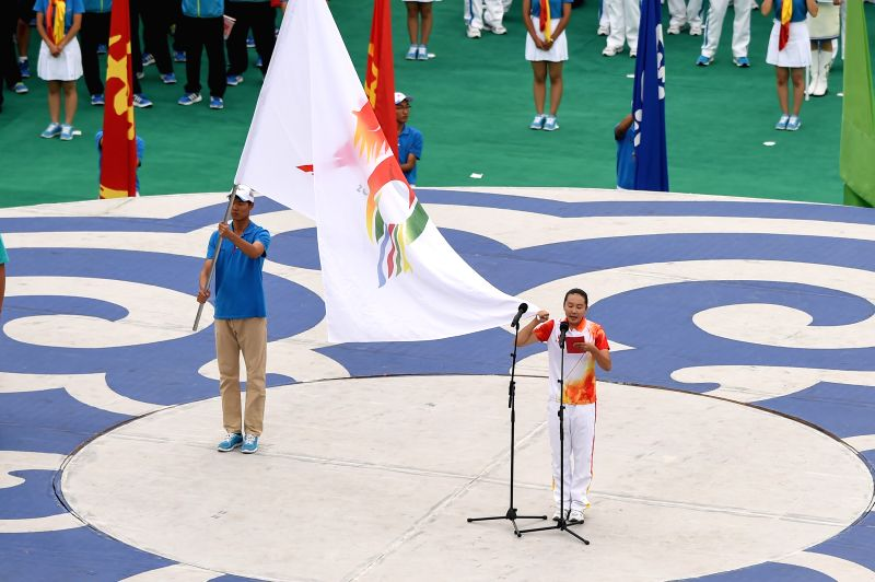 Athlete Urnaa (R), on behalf of all the athletes, takes an oath to follow the rules and pratice good sportsmanship during the opening ceremony of the 10th National ...