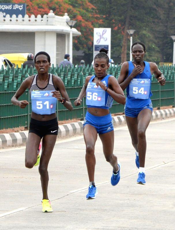 Athletes Irene Chepet Cheptai, Worknesh Degefa and Helah Kiprop in action during TCS World 10K 2017 in Bengaluru on May 21, 2017.