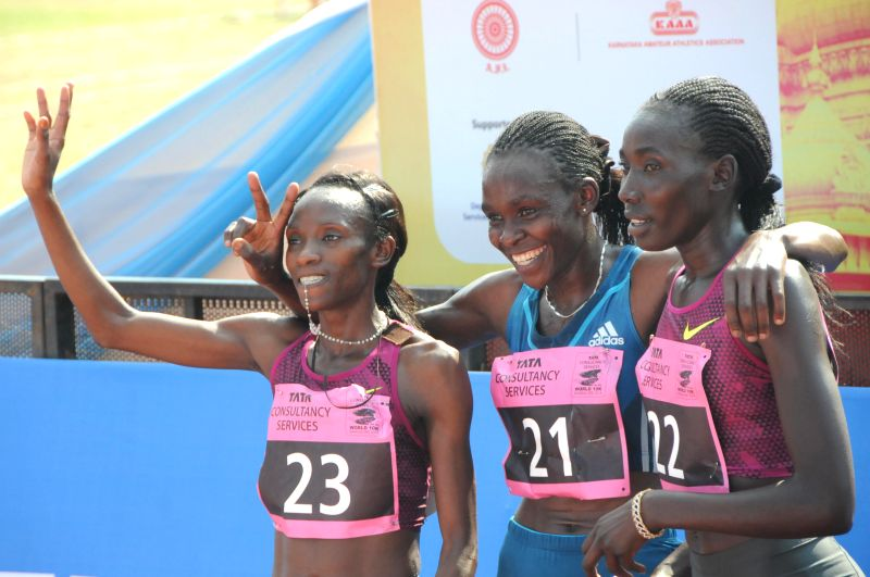Athletes Lacy Kabuu, Joyce Chepkirui, Linet Masai after winning TCS World 10K Bangalore at Kanteerava Stadium in Bangalore on May 18, 2014.