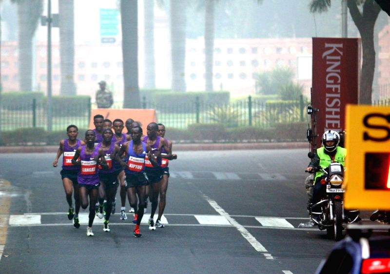 Athletes participate in Airtel Delhi Half Marathon 2015 at India Gate in New Delhi, on Nov 29, 2015.