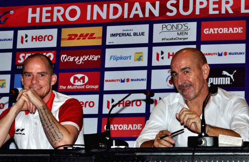 Atletico de Kolkata head coach Antonio Habas and player Iain Hume during a pre-match conference between Atletico de Kolkata and Delhi Dynamos FC in Kolkata on Oct 28, 2015.