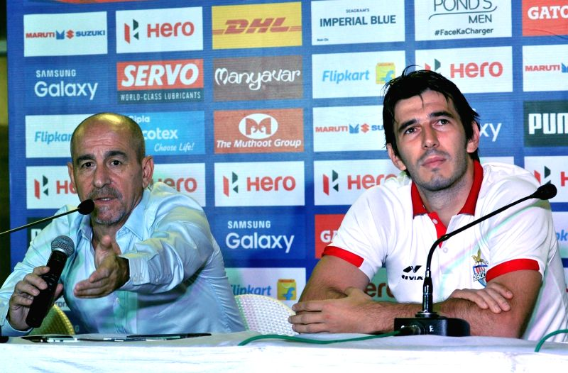 Atletico de Kolkata Head Coach Antonio Habas and player Dejan Lekic during a pre-match press conference in Kolkata, on Nov 17, 2015.