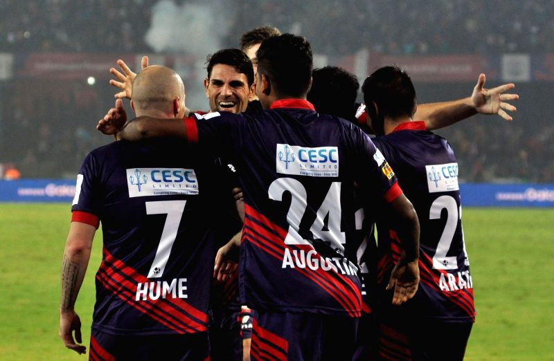 Atletico de Kolkata player Iain Hume with others celebrate after scoring a goal during an ISL match between Atletico de Kolkata and FC Pune City in Kolkata, on Nov 27, 2015.