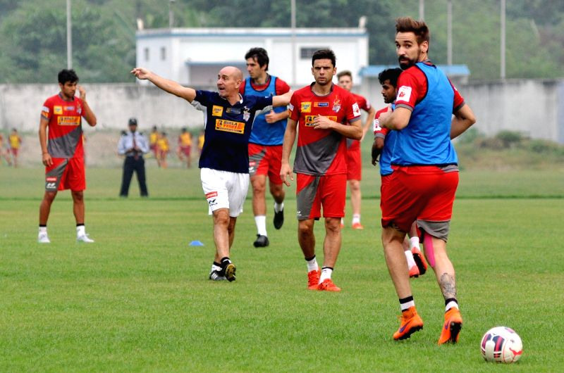 Atletico de Kolkata players in action during a practice session in Kolkata on Nov. 16, 2015.