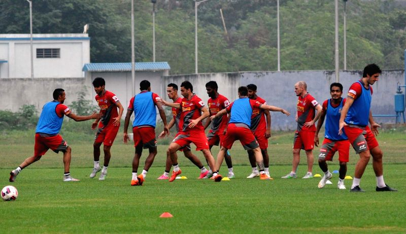 Atletico de Kolkata players in action during a practice session in Kolkata on Dec 1, 2015. 