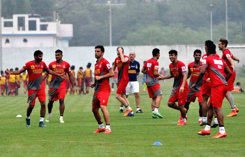 Atletico de Kolkata players in action during a practice session in Kolkata, on Dec 2, 2015.