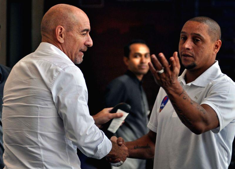 Atletico de Kolkata's head coach Antonio Habas and Delhi Dynamos FC's head coach Roberto Carlos interacts during a pre-match conference between Atletico de Kolkata and Delhi Dynamos FC in ...