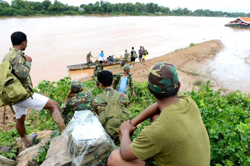 ATTAPEU, July 25, 2018 - Lao soldiers wait to take part in rescue operations in Attapeu, Laos, on July 25, 2018. About 19 people were dead and 49 others remained missing after an under-construction ...