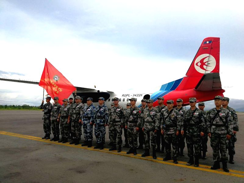 ATTAPEU, July 26, 2018 - A Chinese People's Liberation Army (PLA) medical team arrive at the airport in Attapeu, Laos, July 25, 2018. A medical contingent from the Chinese People's Liberation Army ...