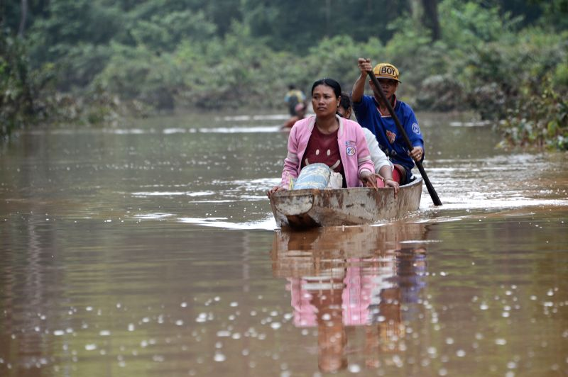 ATTAPEU, July 26, 2018 - Villagers row a boat in flood after an under-construction dam collapsed in Attapeu province, Laos, on July 26, 2018. The under-construction Xepian-Xe Nam Noy hydropower dam ...