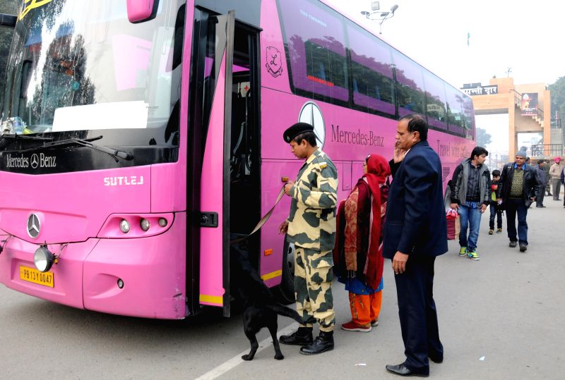 A soldier carries out security checks as a bus arrives at the at Indo-Pak border in Attari, Punjab on Jan 8, 2015. The Delhi-Lahore bus services are available only till Attari-Wagha border ...