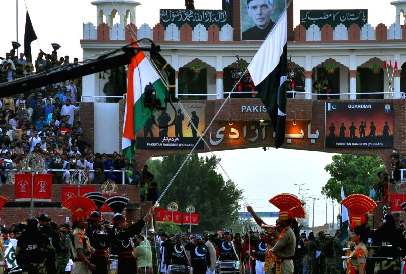 Attari: Border Security Force (BSF) and Pakistan Rangers lower their countries' flags during the Beating Retreat border ceremony on the occasion of 73rd Independence Day, at Attari-Wagah border post on Aug 15, 2019.