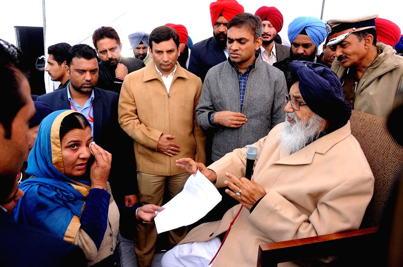 Chief Minister of Punjab, Parkash Singh Badal interacts with people during a Sangat Darshan in Attari on Dec 12, 2014. - Parkash Singh Badal