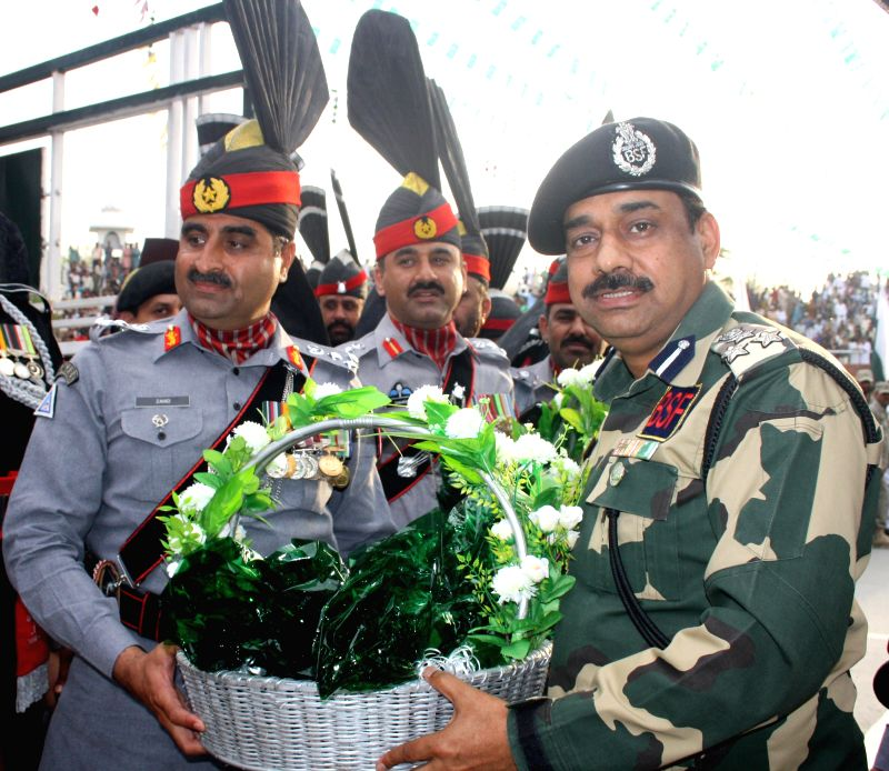 Pakistan Rangers distribute sweets to BSF officials on Pakistan Day at Indo-Pakistan border in Punjab's Attari on March 23, 2015.