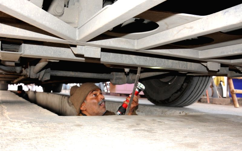 Soldier inspects the under carriage of a bus that arrived at Indo-Pak border from Pakistan, in Attari, Punjab on Jan 8, 2015. The Delhi-Lahore bus services are available only till ...