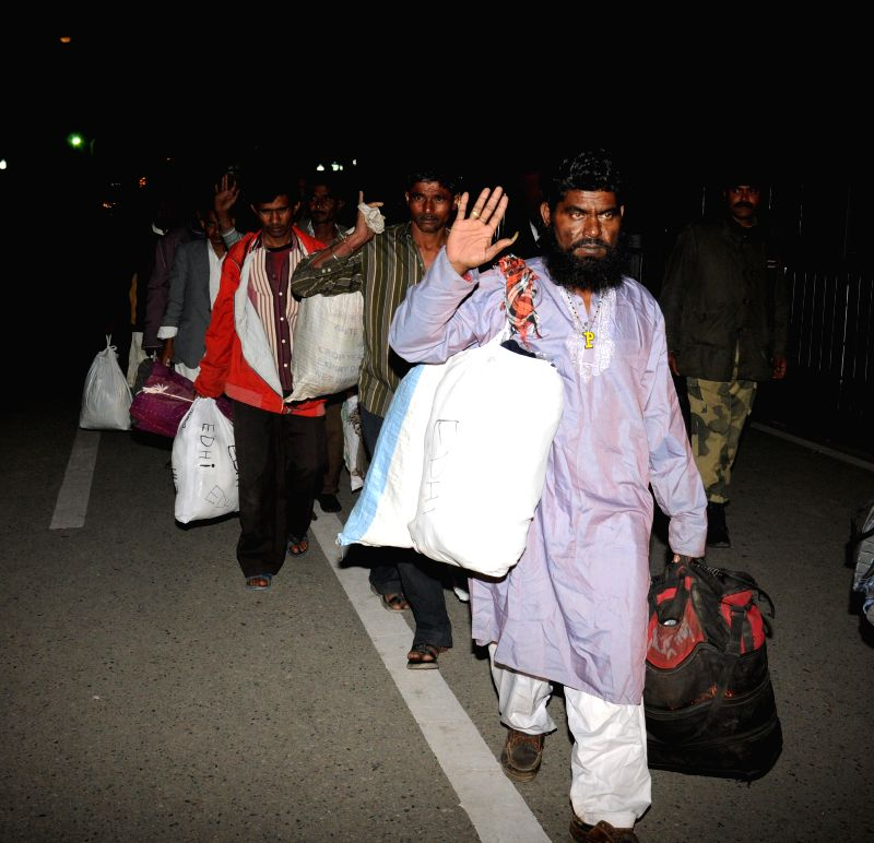 The Indian prisoners who were lodged in Pakistan jails return back after completing their terms via Attari-Wagha (Indo-Pak) land border in Punjab on  Nov 29, 2014.