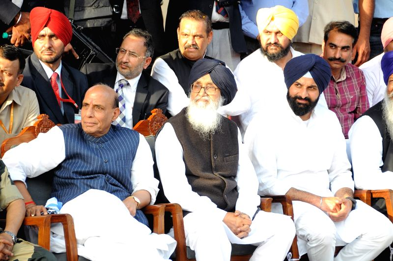 Union Home Minister Rajnath Singh, Punjab Chief Minister Parkash Singh Badal and other leaders watching the daily beating the retreat ceremony conducted by the jawan's of both BSF and Pak ... - Parkash Singh Badal