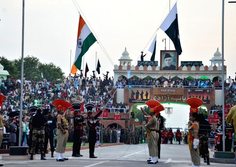 Attri: Beating Retreat ceremony underway at Attari-Wagha border on the eve of Independence Day in Attari near Amritsar on Aug 14, 2019.
