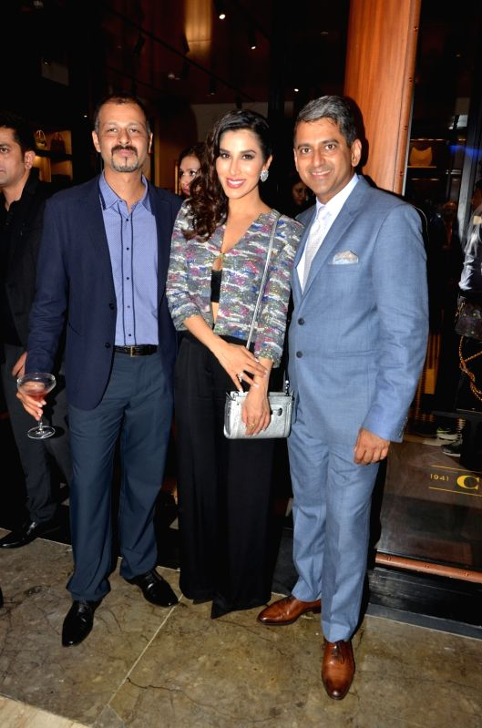 Atul Ruia, Sophie Choudry And Sanjay Kapoor during the Coach launch celebrations in Mumbai, on Aug 4, 2016. Coach celebrates  the launch of its first store in India.