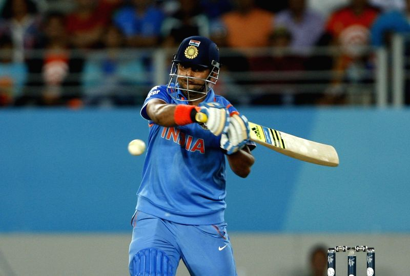 Indian batsman Suresh Raina in action during an ICC World Cup 2015 match between India and Zimbabwe at the Eden Park in Auckland, New Zealand on March 14, 2015. - Suresh Raina