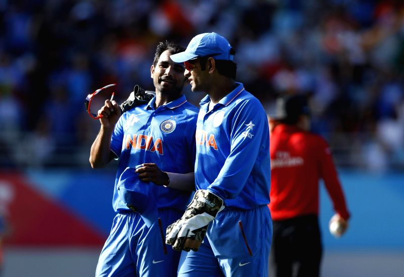 Indian cricketers Mohit Sharma and M S Dhoni during an ICC World Cup 2015 match between India and Zimbabwe at the Eden Park in Auckland, New Zealand on March 14, 2015. - Mohit Sharma