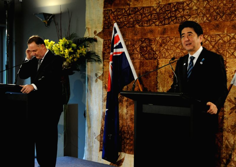 New Zealand Prime Minister John Key (L) holds a joint press conference with visiting Japanese Prime Minister Shinzo Abe at Government House in Auckland, New ...
