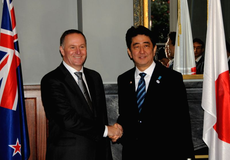 New Zealand's Prime Minister John Key (L) shakes hands with visiting Japanese Prime Minister Shinzo Abe at Government House in Auckland, New Zealand, July 7, 2014. .