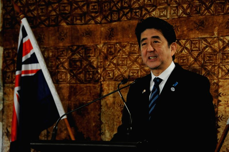 Visiting Japanese Prime Minister Shinzo Abe speaks at a joint press conference along with New Zealand Prime Minister John Key (not in picture) at Government House ..