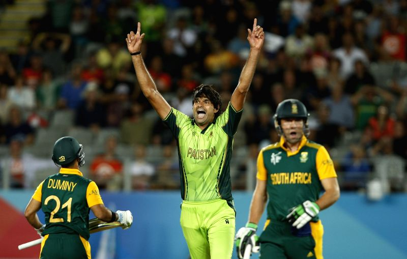Pakistani player Mohammad Irfan celebrates fall of a wicket during an ICC World Cup 2015 match between Pakistan and South Africa at Eden Park, Auckland, New Zealand on March 7, 2015.
