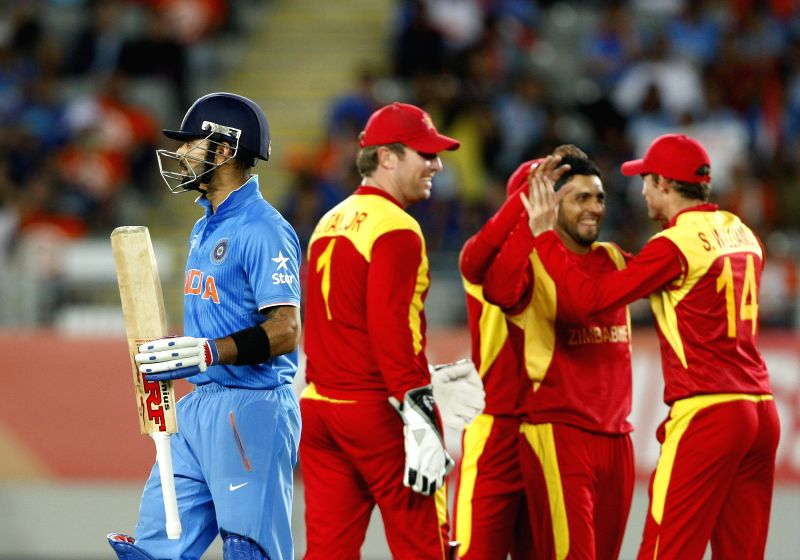 Zimbabwean cricketers celebrate fall of Indian batsman Virat Kohli's wicket during an ICC World Cup 2015 match between India and Zimbabwe at the Eden Park in Auckland, New Zealand on March ... - Virat Kohli