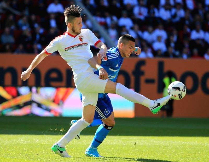 AUGSBURG, May 1, 2017 - FC Augsburg's Jeffrey Gouweleeuw (L) vies with Hamburger SV's Bobby Wood during a German Bundesliga match in Augsburg, Germany, on April 30, 2017. FC Augsburg won 4-0.