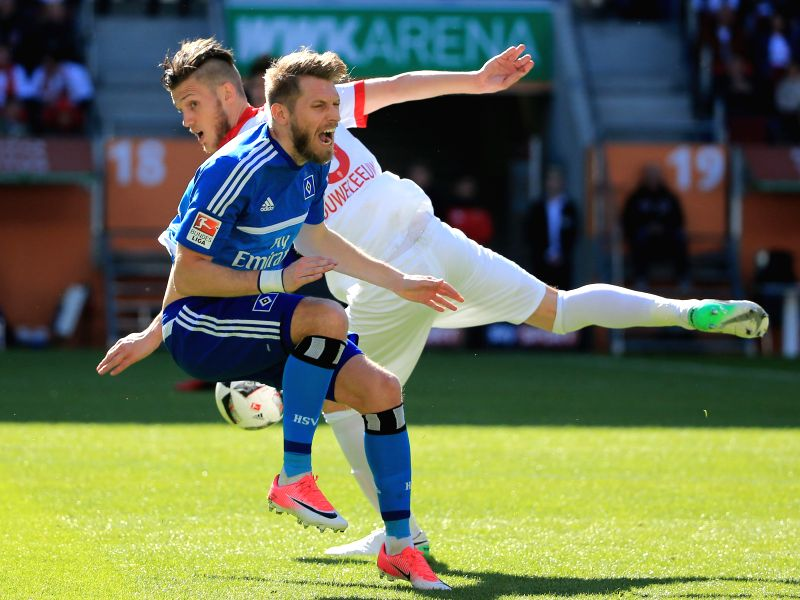 AUGSBURG, May 1, 2017 - Hamburger SV's Aaron Hunt (front) vies with FC Augsburg's Jeffrey Gouweleeuw during a German Bundesliga match in Augsburg, Germany, on April 30, 2017. FC Augsburg won 4-0.