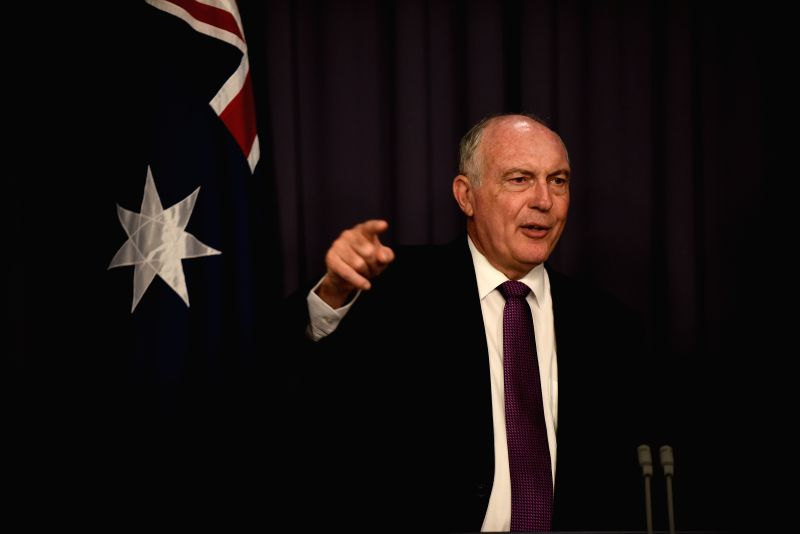 Australian Deputy Prime Minister Warren Truss introduces the highest possible area for the search of MH370 during a press conference at the Parliament House in ... - Warren Truss