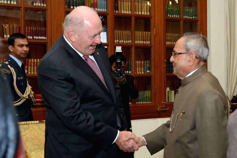 Australian Governor-General Sir Peter Cosgrove calls on President Pranab Mukherjee at Rashtrapati Bhavan in New Delhi, on Dec 2, 2014. - Pranab Mukherjee