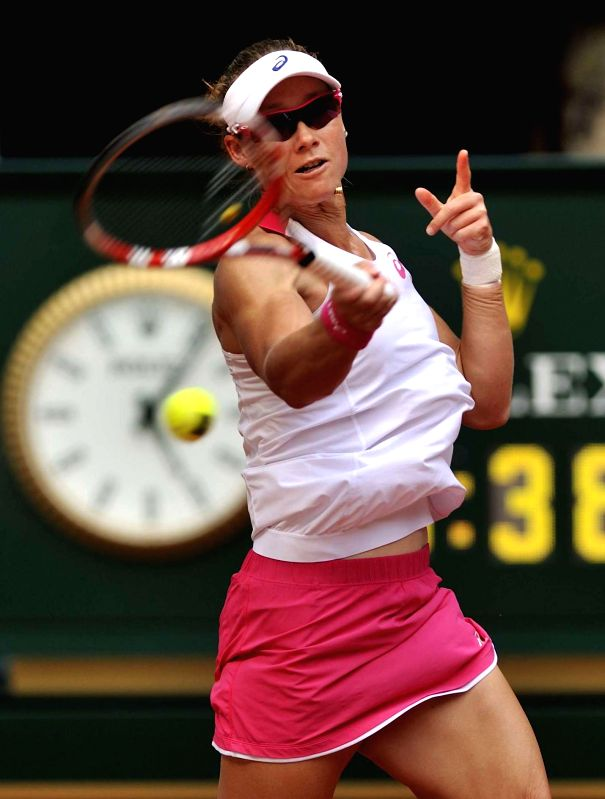 Australian tennis player Samantha Stosur in action against her Russian counterpart Maria Sharapova during the third round match of the WTA Madrid Open women's singles in Madrid, Spain on May 8, 2014.
