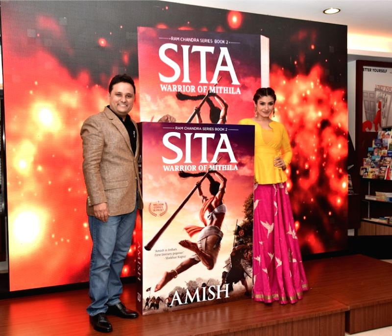 "Author Amish Tripathi with actress Raveena Tandon during the launch of his book ""Sita - Warrior of Mithila""  on May 3, 2017. - Raveena Tandon and Amish Tripathi"