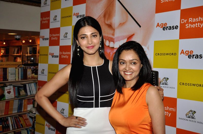Author Dr Rashmi Shetty and actors Shruti Haasan during the launch of her book Age Erase in Mumbai on July 11, 2014. - Shruti Haasan