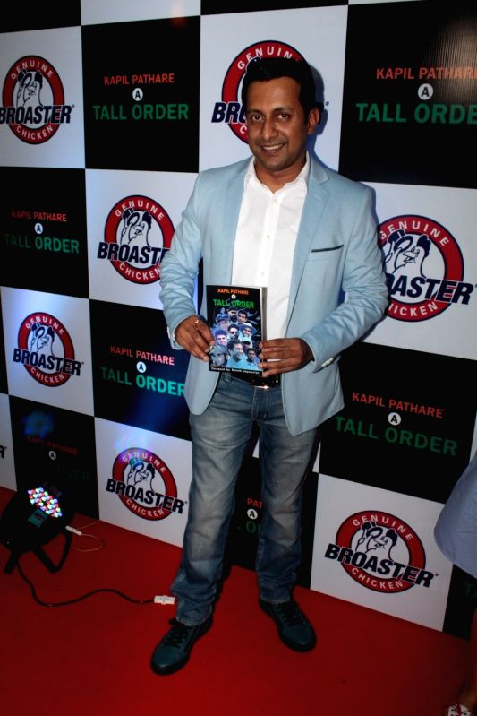 Author Kapil Pathar during celebration of two victorious brands Geniune Broaster Chicken and book A Tall Order in Mumbai, on May 31, 2017.